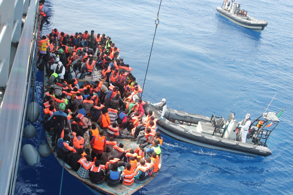 Personnel from the Irish naval rescuing passengers