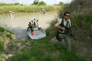 U.S. Border Patrol agents looking for migrants along the Rio Grande River in Texas.