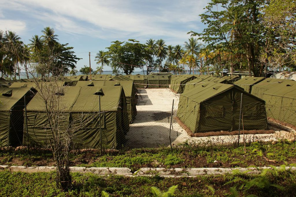 Green army tents are lined up in rows in the Manus camp as temporary accommodation for asylum seekers.