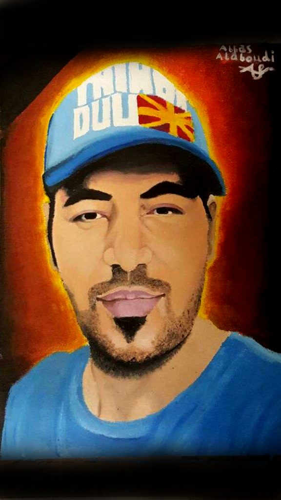 A painted portrait of Omid Masoumali by an artist also detained on Nauru Abbas Alaboudi. It is similar to a photo of Omid that circulated following his death. He wears a hat and t-shirt. In the painting, there is almost a halo of light coming from behind him.