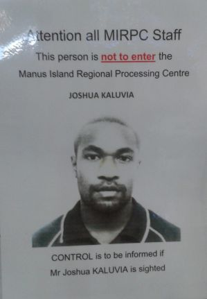 A poster placed in the Manus Island RPC shows a photo of one of the men who was involved in Reza Barati's murder. He was charged, sentenced and subsequently escaped from jail. It reads 'Attention all MIRPC staff. This person is not to enter the Manus Island Regional Processing Centre. Joshua Kaluvia [photo] CONTROL is to be informed if Mr Joshua KALUVIA is sighted'