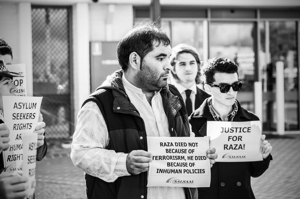 Protesters including Hazara community members stand outside Perth Detention Centre with signs reading 'Justice for Raza!' and 'Raza died not because of terrorism, he died because of inhuman policies'.