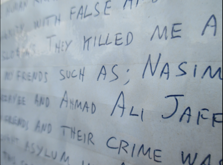 Detail of Khodayar's final statement written on paper.