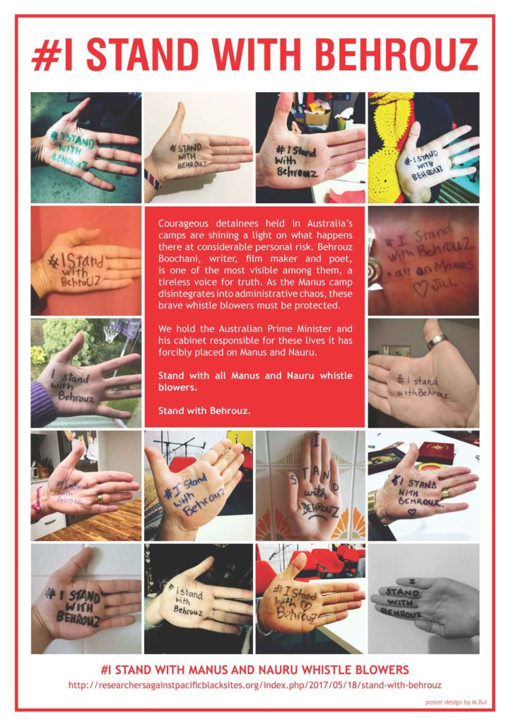 Poster with a collage of photos of people's palms with the words '#I Stand With Behrouz' written on them. '#I Stand With Behrouz' is written at the top of the poster. A text box in the centre provides an explanation about the campaign and a link to further information is noted at the bottom of the psoter.