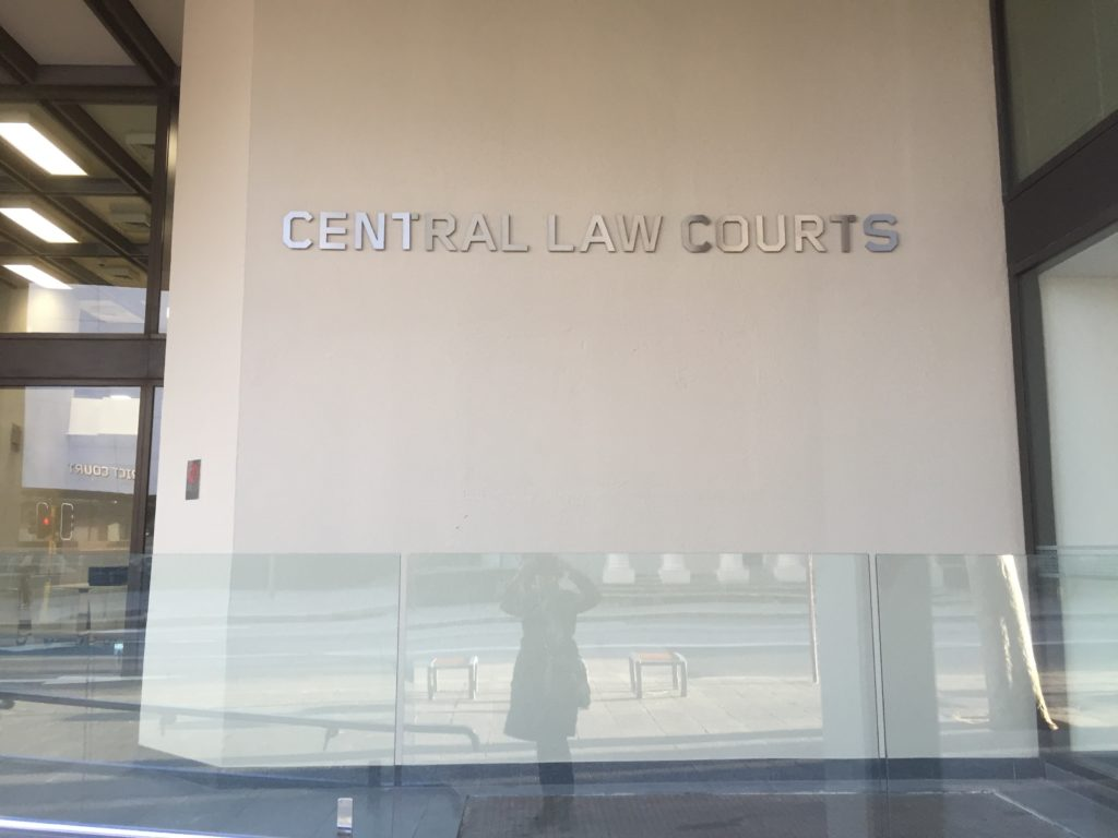 A wall outside the Perth Court with signage that reads 'Central Law Courts'.