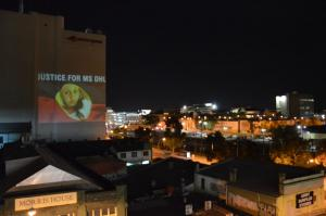 Projection of Ms Dhu onto city building, Whadjuk Country (Perth), 11 March 2016
