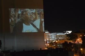 Projection of Ms Dhu's Grandmother Aunty Carol Roe onto a city building, Whadjuk Country (Perth), 11 March 2016