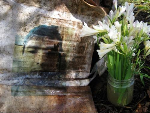 Weathered photo of Khodayar Amini with flowers, 2016.