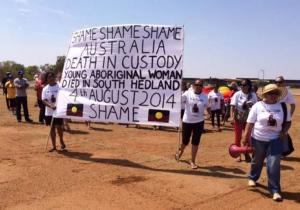 National Day of Action, demonstrators in South Hedland hold banner for Ms Dhu that says 'Shame Shame Shame Australia', 23 October 2014.