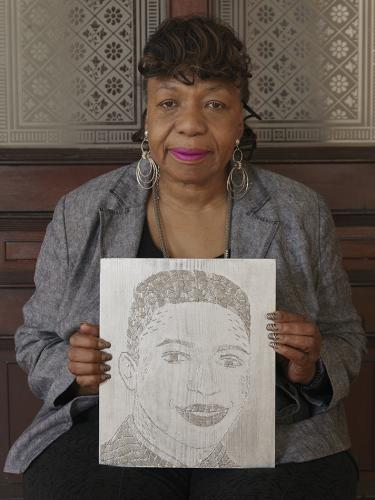 Gwen Carr holding her son Eric Garner (1970, USA–2014, USA)Horticulturist at the New York City Parks