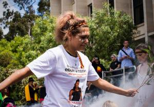 National Day of Action, a young Aboriginal woman dances during smoking ceremony outside Parliament House on Whadjuk Country (Perth), 23 October 2014
