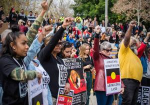 Crowd of protesters raise their fists at Black Lives Matter rally, Whadjuk Country (Perth), 25 July 2016