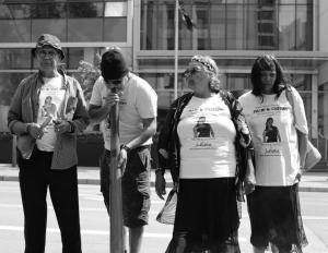 Uncle Ben Taylor, his nephew, Ms Dhu's Grandmother and Mother stand together outside the Coroner's Court, Whadjuk Country (Perth), 28 November 2015