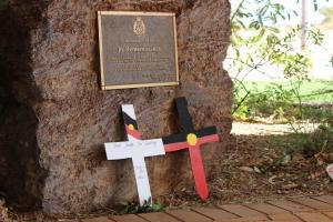 Crosses placed adjacent to plaque at South Hedland Police Station, South Hedland, 30 April 2015