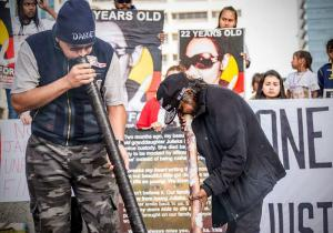 Two men play the didgeridoo at protest to mark the One Year Anniversary of Ms Dhu's death in custody, Whadjuk Country (Perth), 4 August 2015