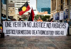 Supporters gather behind large banner at protest marking Anniversary of Ms Dhu's death in custody, Whadjuk Country (Perth), 4 August 2015