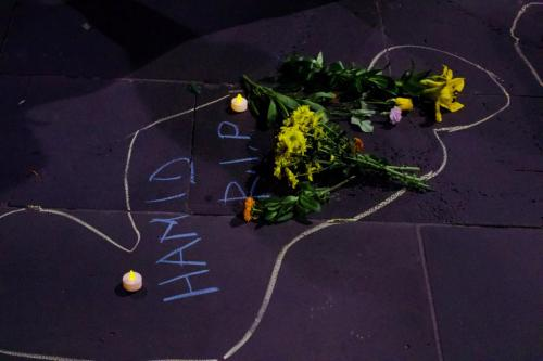 Flowers laid in chalk outline at Vigil for Salim, Narrm, Kulin Nations (Melbourne), 2018.