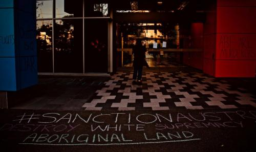Chalked messages outside Immigration Office at WACA Border Force Protest, Narrm, Kulin Nations (Melbourne), 2018. Photo: Charandev Singh.
