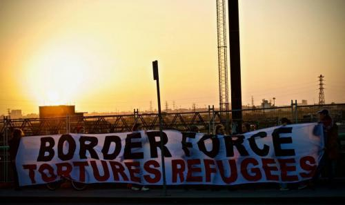 'Border Force Tortures Refugees' banner held at WACA Border Force Protest, Narrm, Kulin Nations (Melbourne), 2018. Photo: Charandev Singh.