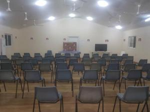 Chairs assembled in hall to mark - 4 year anniversary of Reza Barati's murder, Hillside Camp, Lorengau, 2018.