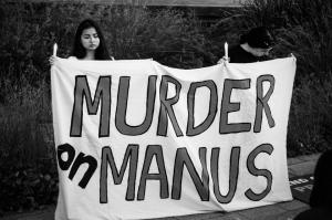 Murder on Manus banner held at one year anniversary action, Perth, 2015.