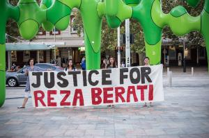 'Justice for Reza Berati' banner held outside train station in Forrest Place to mark two year anniversary, Perth, 2016.