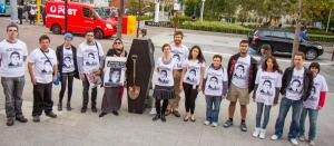 Activists gather to mark 100 days since the death of Reza Barati, they wear shirts calling for justice and stand beside a coffin, Perth, 2014.