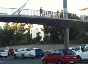 Justice for Reza Barati Banner Drop across freeway bridge, Perth, 2014.