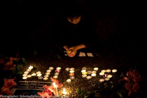 Candles spell out 'SALIM' at Vigil for Salim, Sydney, 2018. Photo: Zebedee Parkes.