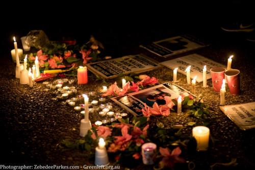 Candles and flowers laid at vigil for Salim, Sydney, 2018. Photo: Zebedee Parkes.